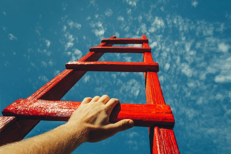 climbing a red ladder to the sky