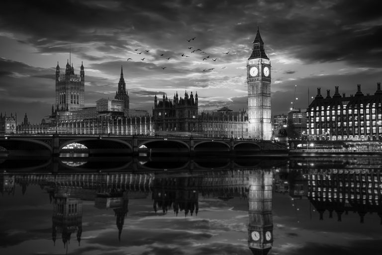 Westminster and the Big Ben clocktower by the Thames river in London