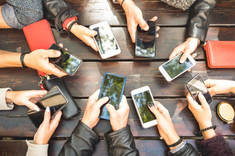 Hands and smartphones